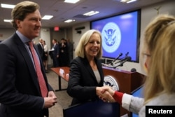 U.S. Secretary of Homeland Security Kirstjen Nielsen and Undersecretary Chris Krebs greet election security workers at the DHS Election Operations Center and the National Cybersecurity and Communications Integration Center in Arlington, Virginia, Nov. 6, 2018.