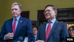 Cambodia National Rescue Party's President Kem Sokha, right, talks to the media as U.S. Ambassador to Cambodia W. Patrick Murphy listens after a welcoming meeting at Kem Sokha's house in Phnom Penh, Cambodia, Monday, Nov. 11, 2019.