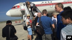 FILE - Passengers board an Air Koryo plane bound for Beijing, at the Pyongyang International Airport in Pyongyang, North Korea, June 27, 2015.