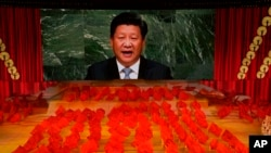 在北京举行的庆祝中共成立100周年的庆典上习近平的画像出现在屏幕上。(2021年6月28日)