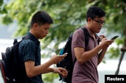 "People play ""Pokemon Go"" by Hoan Kiem Lake in Hanoi, Vietnam, Aug. 18, 2016."