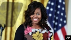 FILE - First lady Michelle Obama speaks at the White House.