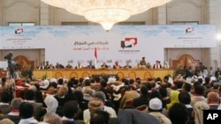 Yemeni participants attend the closing of the so-called national dialogue talks in Sanaa, Yemen, Saturday, Jan. 25, 2014. The long-running negotiations has brought delegates from across the country to draw up a blueprint for a new constitution under a tra