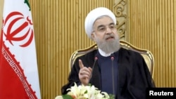 Iranian President Hassan Rouhani speaks in Tehran after returning from the annual United Nations General Assembly, Sept. 29, 2015.