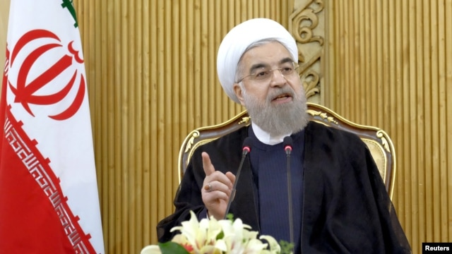 FILE - Iranian President Hassan Rouhani speaks in Tehran. Rouhani ordered his defense minister to expand the ballistic missile program as a response to the threatened U.S. sanctions.