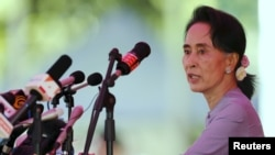 FILE - Myanmar's National League for Democracy Party leader Aung San Suu Kyi is seen speaking to media in Yangon.