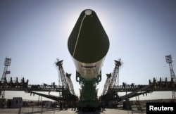 FILE - The Russian Progress-M spacecraft is ready to be lifted on its launch pad at Baikonur cosmodrome, Kazakhstan, July 1, 2015.