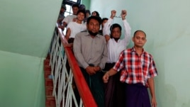 Muslim men accused of murdering a monk, believed to be the first killing in the March unrest, walk out of court in Meikhtila, Burma, April 24, 2013.