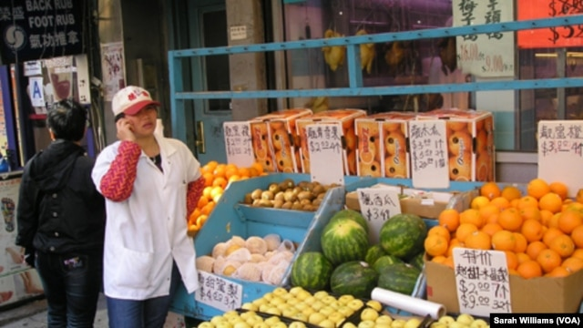 Vendor at food market in New York City's Manhattan Chinatown (October 2013)