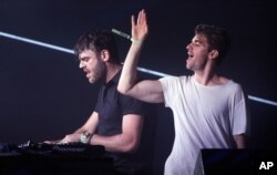 FILE - Andrew Taggart, right, and Alex Pall with the The Chainsmokers performs at the Bonnaroo Music and Arts Festival.