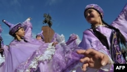 "Kyrgyz women wearing traditional costumes perform during the celebrations of Nowruz (New Year) at the central Ala-Too Square in Bishkek on March 21, 2016. Nowruz, ""The New Year"" in Farsi, is an ancient festival marking the first day of spring in Central A"