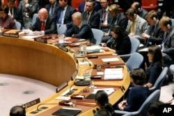 Russia's U.N. Ambassador Vassily Nebenzia, upper left, addresses the United Nations Security Council, as U.S. Ambassador Nikki Haley, right, listens at U.N. headquarters, Monday, Sept. 17, 2018.