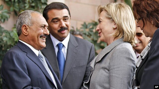 Yemeni President Ali Abdullah Saleh, left, shakes hands with US Secretary of State Hillary Clinton following her arrival for a visit to Yemen January 11, 2011.