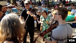 Musical performances were not limited to the half-dozen stages at the folk festival at Glen Echo Park.