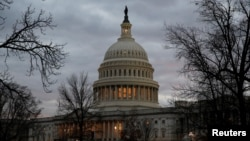 The U.S. Capitol building is lit at dusk ahead of planned votes on tax reform in Washington, Dec. 18, 2017.