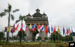 Flags of the 10-member ASEAN (Association of Southeast Asian Nations) and its dialogue partners are placed around the Patuxay Monument in downtown Vientiane, Laos, Sept. 5, 2016.