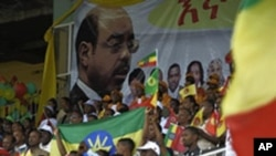 Supporters of the Ethiopian People's Revolutionary Democratic Front (EPRDF) sit in stands under a portrait of Prime Minister Meles Zenawi, Addis Ababa, 20 May 2010