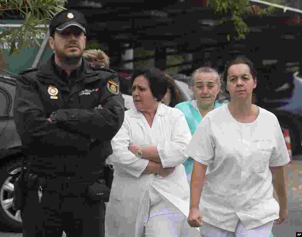 Hospital staff take part in a protest, demanding the resignation of Health Minister Ana Mato for the handling of a Spanish nurse who contracted the Ebola virus, outside Carlos III Hospital in Madrid, Spain, Oct. 7, 2014.