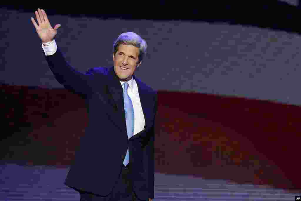 John Kerry waves as he walks to the podium to address the Democratic National Convention in Charlotte, North Carolina, September 6, 2012.