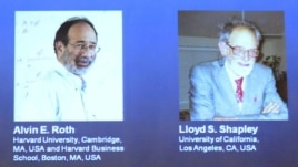 Pictures of U.S. economists Alvin Roth and Lloyd Shapley, who won the 2012 Nobel prize for economics, are seen projected at the Swedish Royal Academy of Sciences in Stockholm, Sweden, October 15, 2012.