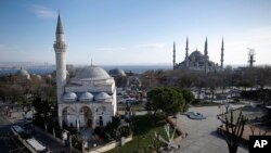 A view of the Sultan Ahmed Mosque, right, better known as the Blue Mosque in the historic Sultanahmet district of Istanbul, the area of an explosion, Tuesday, Jan. 12, 2016. The explosion killed several people and wounded more than a dozen others Tuesday morning in a historic district of Istanbul popular with tourists. Turkish President Recep Tayyip Erdogan said a Syria-linked suicide bomber is believed to be behind the attack.(AP/Emrah Gurel)