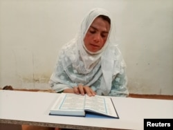 Rani Khan, a transgender woman who teaches the Koran, reads the Koran at Pakistan's first transgender only madrasa or a religious school, in Islamabad, Pakistan February 25, 2021. Picture taken February 25, 2021. REUTERS/Salahuddin NO RESALES. NO ARCHIVES
