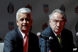 Sunil Gulati, left, President of the United States Soccer Federation, and Decio de Maria, President of the Mexican Football Federation, hold a news conference, April 10, 2017, in New York. The U.S., Mexico and Canada announced a joint bid for the 2026 event.