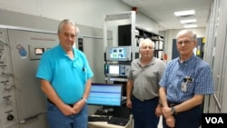 Gary Koster, Broadcast Radio Technician and transmitter expert, Gerhard Straub, Director USAGM Broadcast Technologies Division and Macon Dail, Chief Engineer, setting up a digital radio test at the Greenville, NC, Transmitting Station.