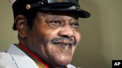 "FILE - legendary musician Fats Domino is named ""Honorary Grand Marshall"" of the Krewe of Orpheus, the star-studded Carnival club that traditionally parades the night before Mardi Gras in New Orleans."