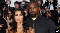 "Kim Kardashian West, left, and Kanye West attend The Metropolitan Museum of Art's Costume Institute benefit gala celebrating the opening of the ""Camp: Notes on Fashion"" exhibition on May 6, 2019, in New York."