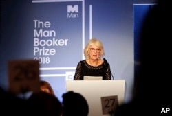 Britain's Camilla, the Duchess of Cornwall, addresses the guests during the Man Booker Prize for Fiction 2018, the prize's 50th year, at the Guildhall in London, Oct. 16, 2018.