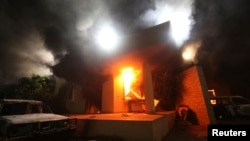 FILE - The U.S. Consulate in Benghazi is seen in flames during a protest by an armed group said to have been protesting a film being produced in the United States, Sept.11, 2012.