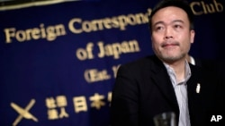 FILE - In this Jan. 22, 2015 file photo, Japanese freelance journalist Kosuke Tsuneoka speaks at the Foreign Correspondents' Club of Japan in Tokyo.