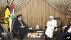 Lebanon's Hezbollah leader Sayyed Hassan speaks with Qatar's Prime Minister and Foreign Minister Sheikh Hamad, as Turkey's Foreign Minister Davutogluat and Hezbollah official al-Khalil listen during their meeting in Beirut, 19 Jan 2011