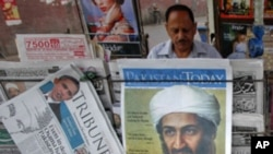 A roadside vendor sells newspapers with headlines about the death of al-Qaeda leader Osama bin Laden, in Lahore May 3, 2011. Pakistan's president acknowledged for the first time on Tuesday that his security forces were left out of a U.S. operation to kill