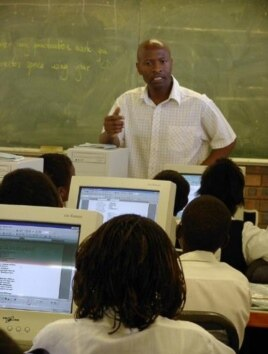 Students listen to ICT instruction at KwaMhlanga High School in Mpumalanga, South Africa.