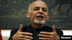 Afghanistan's President Ashraf Ghani speaks during a news conference in Kabul, Afghanistan, Dec. 31, 2015.