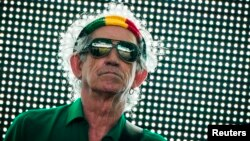 "FILE - Keith Richards of the Rolling Stones performs during their ""14 on Fire"" show at Waldbuehne in Berlin, June 10, 2014."