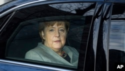 German Chancellor Angela Merkel arrives at the headquarters of the Social Democratic party in Berlin, Monday, Feb. 5, 2018 prior to another day in the coalition talks on forming a new German government between Merkel's Christian Democratic bloc and the Social Democratic party.