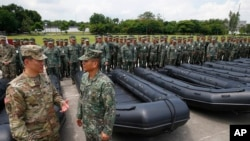 U.S. Army Col. Ernest Lee (left) inspects with Philippine Marine Corps Commandant Maj.Gen. Emmanuel Salamat, military weapons and equipment from the U.S. military to the Philippine marines, June 5, 2017. The new weapons will be used to fight terrorism and against Muslim militants in Marawi.