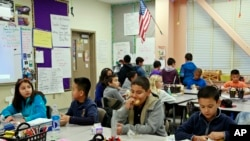 FILE - Students are served breakfast at the Stanley Mosk Elementary School in Los Angeles. In this Los Angeles Unified School District program, and in other major urban school districts, breakfast is increasingly being served inside the classroom.