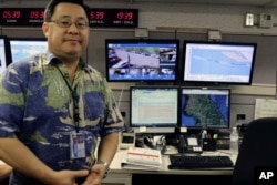 Jeffrey Wong, the Hawaii Emergency Management Agency's current operations officer, shows computer screens monitoring hazards at the agency's headquarters in Honolulu, July 21, 2017. Hawaii is the first state to prepare the public for the possibility of a North Korean missile strike.