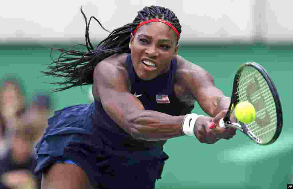 Serena Williams, of the United States, reaches for a return against Daria Gavrilova, of Australia, at the 2016 Summer Olympics in Rio de Janeiro, Aug. 7, 2016.