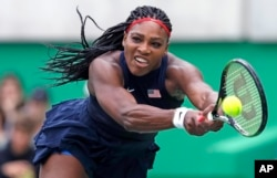 Rio Olympics Tennis: Serena Williams, of the United States, reaches for a return against Daria Gavrilova, of Australia, at the 2016 Summer Olympics in Rio de Janeiro, Brazil, Sunday, Aug. 7, 2016.