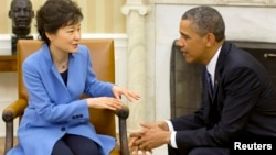 Пак Кын Хе и Барак Обама