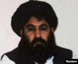 FILE - Mullah Akhtar Mansoor is seen in this undated handout photo from the Taliban.
