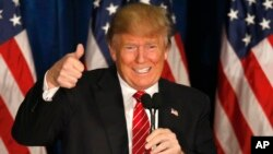 Republican presidential candidate Donald Trump gives a thumbs up at campaign stop in Portland, Maine, March 3, 2016.
