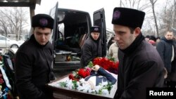 Sahrana žrtve stradale u bombaškom napadu u Volgogradu 1.januar, 2014.