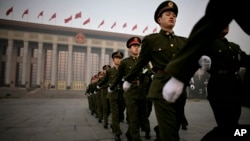 Chinese police officers before a session of the National People's Congress on Monday, March 10, 2008. (AP Photo/Oded Balilty)