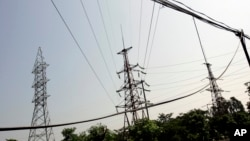 Power lines are seen in Ninh Binh Power Plant, which is a coal fired power plant to supply electricity, in Ninh Binh Province in Vietnam, Wednesday, Sept. 19, 2007. The Asian Development Bank agreed Friday to loan Vietnam nearly $1 billion to build a coa
